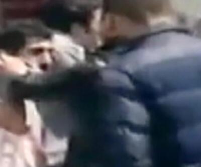 VİDEO: Polis zorla poşu takıp fotoğraf çekti
