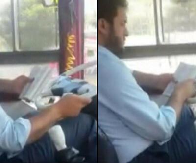 Otobüs kullanırken kitap okuyan sürücü kamerada
