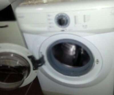 Çamaşır makinesinin altından gizli sığınak çıktı
