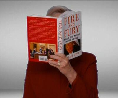 Grammy'de Clinton sürprizi: Yüzünü kitapla sakladı