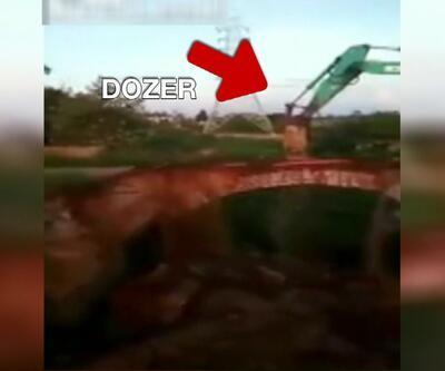 Üstünde durduğu köprüyü yıktı