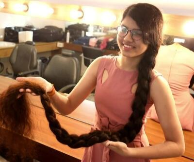 Saçlarının uzunluğu 170.5 cm