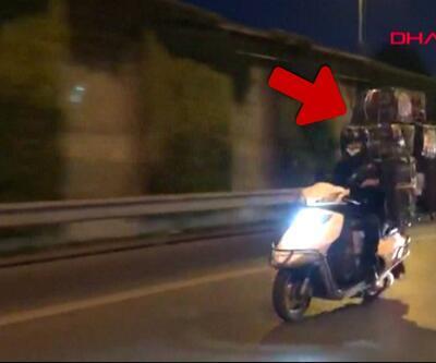 Trafikte motosikletle 8 büyük koli taşıdı