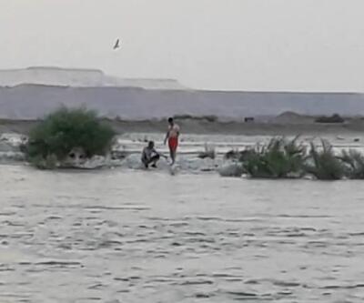 Baraj kapakları açılınca avlandıkları çayda mahsur kaldılar