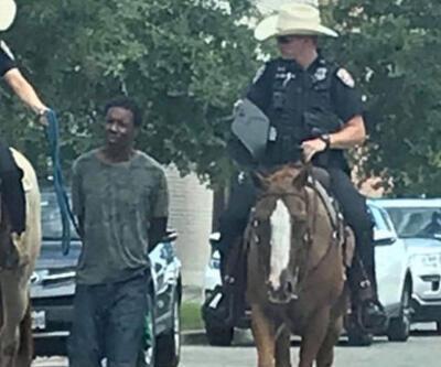 ABD'de skandal görüntü! Kelepçeli şekilde atlı polislerin arkasında yürütüldü