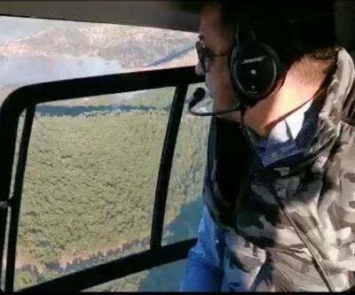 Bakan Pakdemirli, İzmir'deki orman yangını bölgesini havadan inceledi
