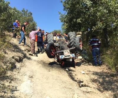 Devrilen traktördeki oğul öldü, baba yaralandı