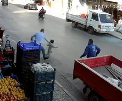 Küçük çocuğun kamyonetin altında kalmaktan son anda kurtarıldı
