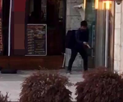 Cezaevine girmek için banka camını kırdı