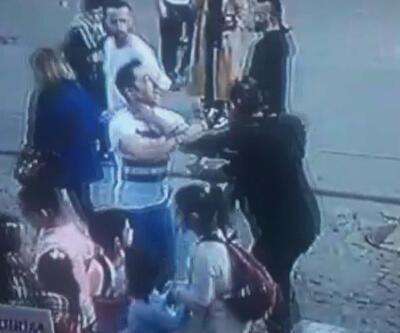 Yanındaki kadını döven kişiye dayak kamerada