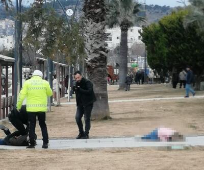 Polis gelene kadar eşinin başında bekledi
