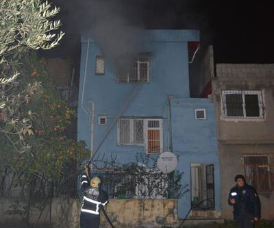 Eşini dövüp, evi ateşe verdi
