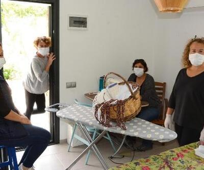 Datçalı kadınlar el ele verdi, maske üretimine başladı