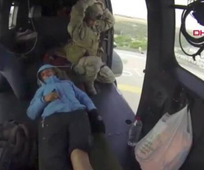 Yaralı dağcı için helikopterli kurtarma operasyonu | Video