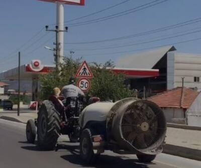 Köpeğin, traktörün üzerindeki yolculuğu böyle görüntülendi