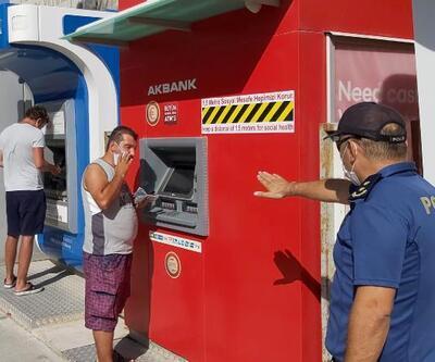 ATM'den para çeken maskesiz vatandaş polisten esprili uyarı: '1000 TL fazla çek'
