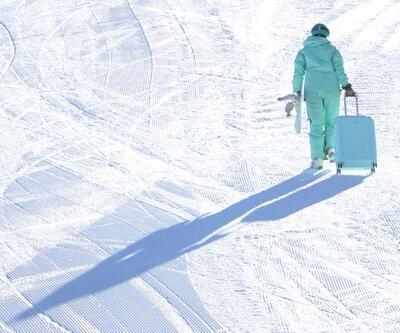 Palandöken'de bavul ile snowboard şaşırttı