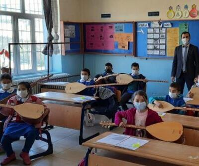 Gurbetçi vatandaştan köy okuluna müzik atölyesi