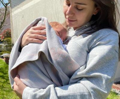 Merve Özbey minik bebeğiyle bahçede poz verdi