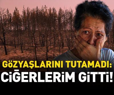 Yanan ağaçlara bakınca gözyaşlarını tutamadı