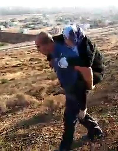 Polis yaralı kadını ambulansa kadar sırtında 2 kilometre taşıdı