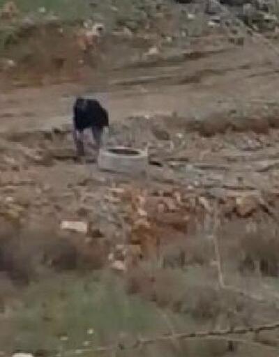 Rögarı taşlarla doldururken görüntülendi