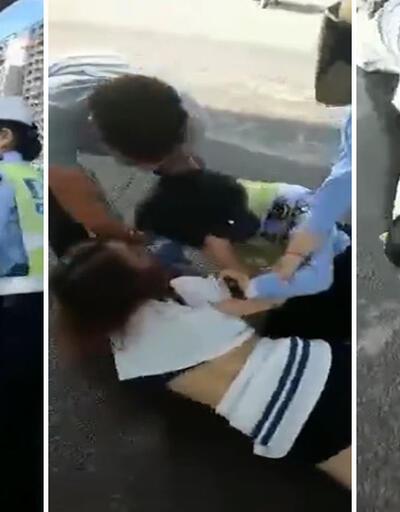 Kadın polis, durdurduğu sürücünün eşi ile birbirine girdi