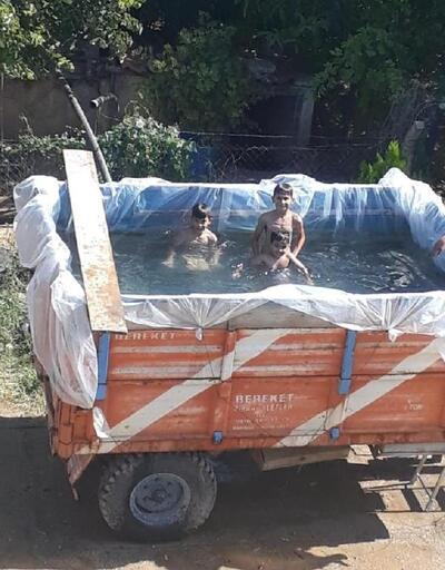 Torunları için traktörün römorkunu havuz yaptı