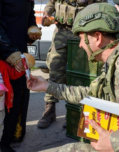 Rasulayn halkına insani yardım malzemesi dağıtımı