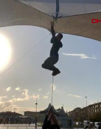 Pazar çadırı uçmasın diye tuttu ama kendisi uçtu