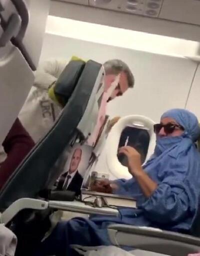 Uçakta 'FETÖ'cüyüm' diye bağıran kadının oğlu tanıdık çıktı