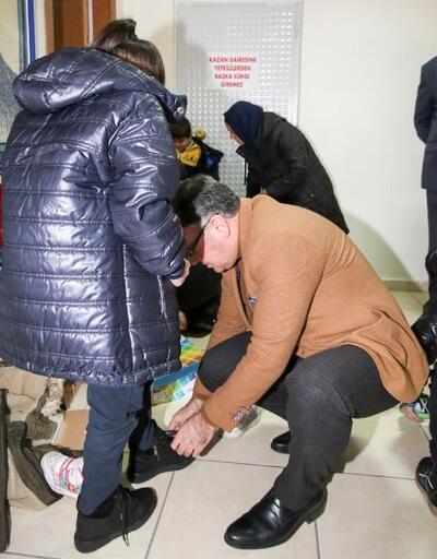 Hacılar'da 250 ihtiyaç sahibi öğrenciye mont ve kışlık ayakkabı