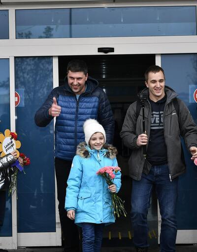 'Hoş geldiniz' yazan dövizlerle karşılandılar! Yılbaşını Kayseri'de geçirecekler