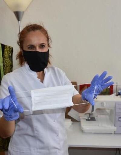 Gönüllü 3 kadın maske üretimine başladı