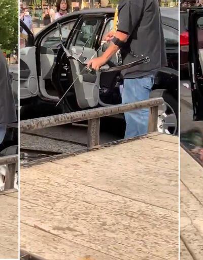 ABD'deki protestolarda olay görüntüler: Elindeki ok ve yayla göstericileri vurmaya çalıştı!
