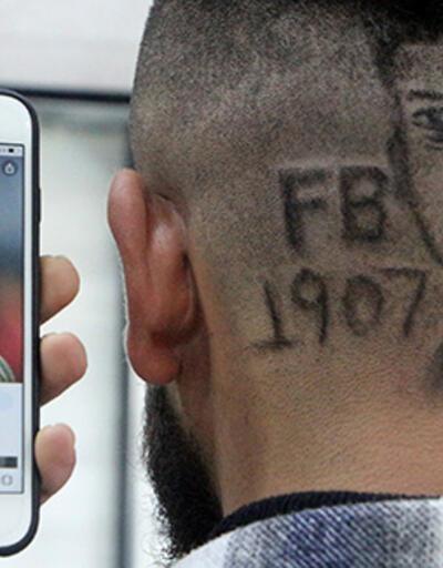 Berberden 3 boyutlu saç tıraşı hizmeti; Mesut Özil'in portresini başına işletti