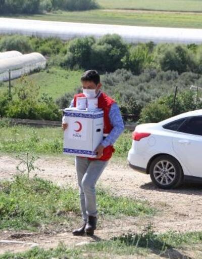 Kızılay Serik'te Ramazan paketi ve nakdi yardım dağıttı
