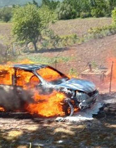Dalları yakarken alevlerin sıçradığı otomobili yandı