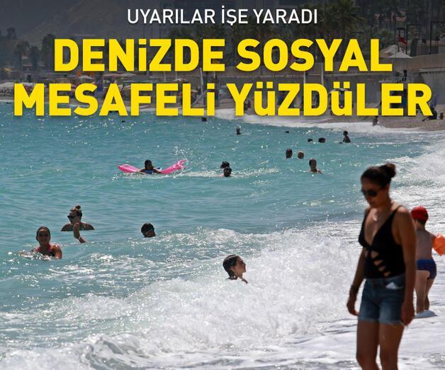 Son dakika: Uyarılar işe yaradı, denizde bile sosyal mesafeli yüzdüler