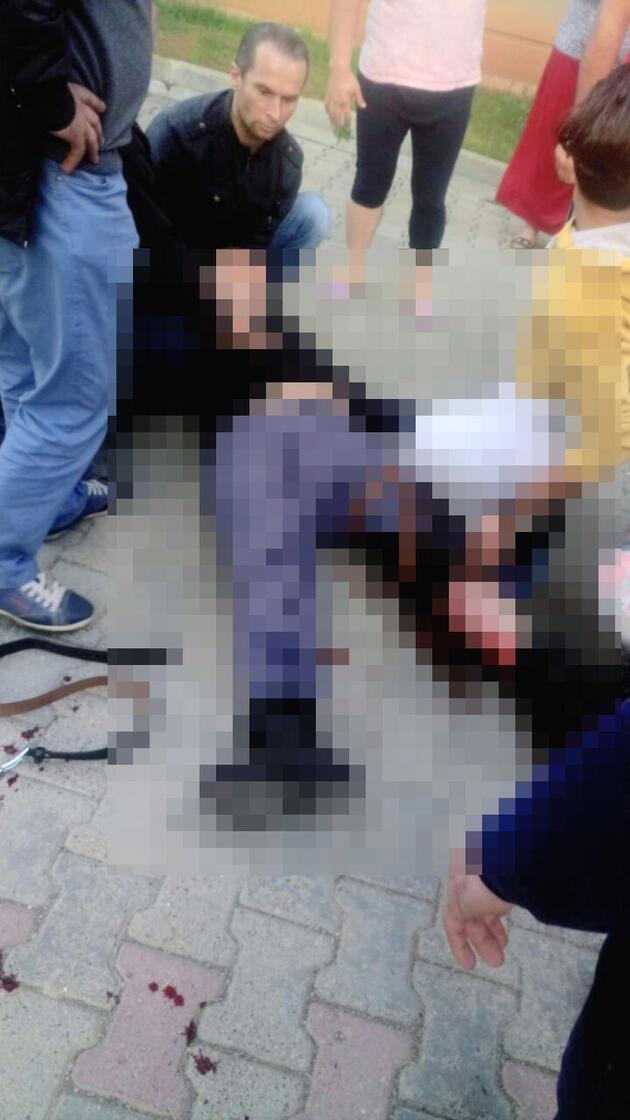 Broşür dağıttırmayan apartman görevlisi ve oğlunu vurdu