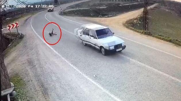 Otomobilin açılan kapısından düşen çocuk ölümden döndü