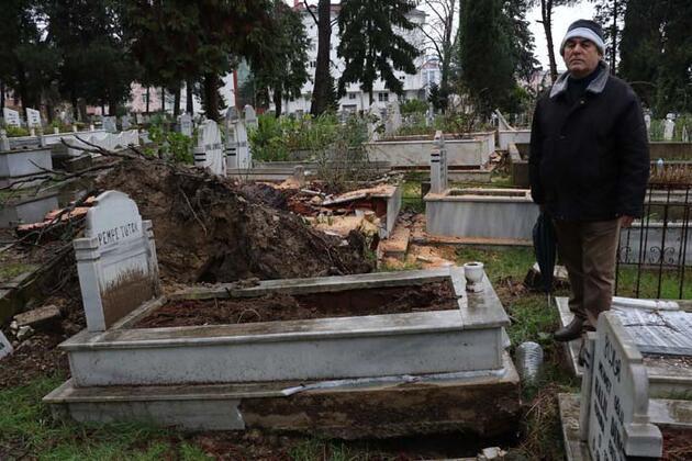 Mezarların üzerine ağaçlar devrildi