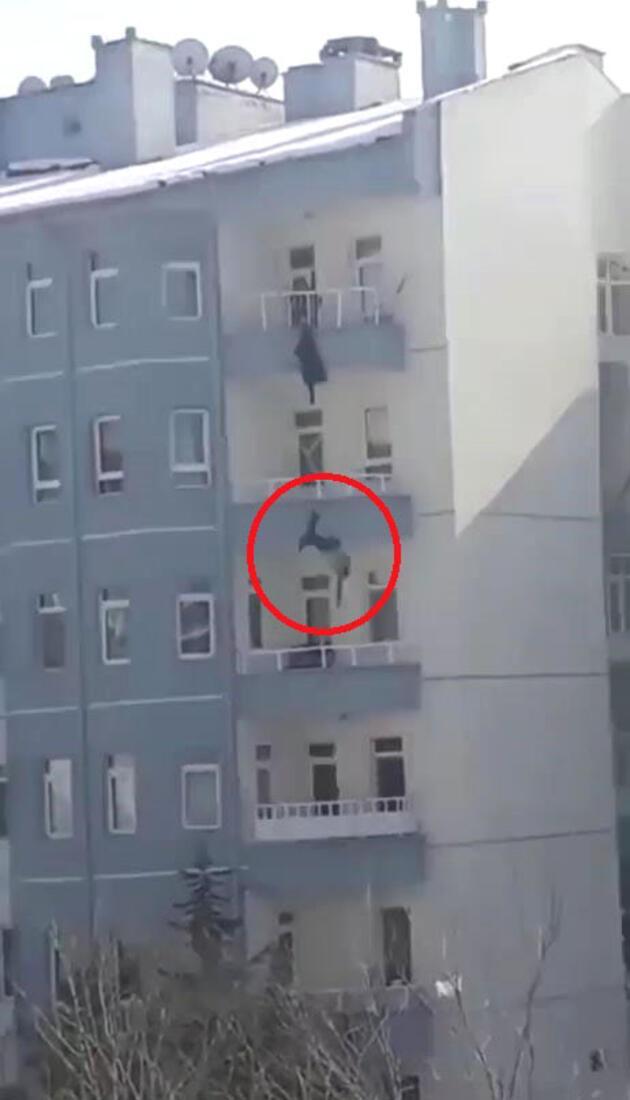 Balkondan atlayan kocasını son anda yakaladı ancak kurtaramadı
