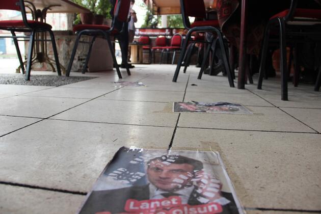 Macron'un fotoğrafına basıp çaylarını yudumluyorlar