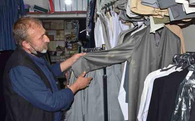 Hac malzemeleri satan mağazadaki kıyafetlere çamaşır suyu ile zarar verdi