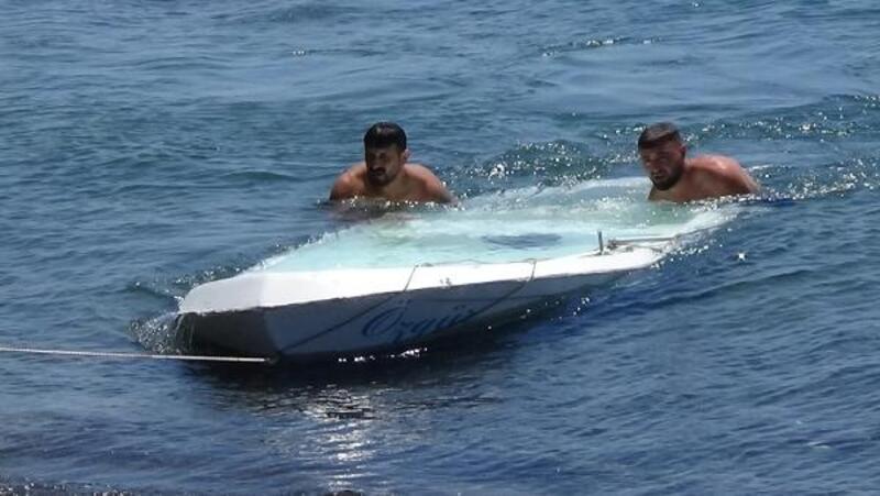 Alabora olan kayıktaki aile, kıyıya yüzerek çıktı