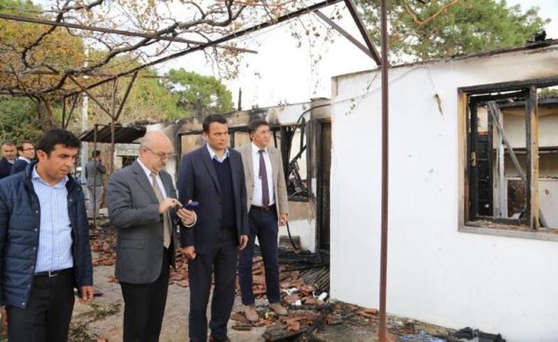 Evi yanan ailelere ziyaret