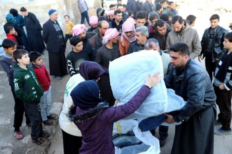 İHH'dan Suriye'deki bin 300 aileye kışlık yardım