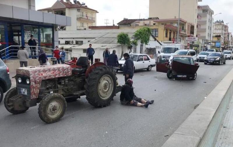 Traktörden asfalta düştüler, burunları bile kanamadı
