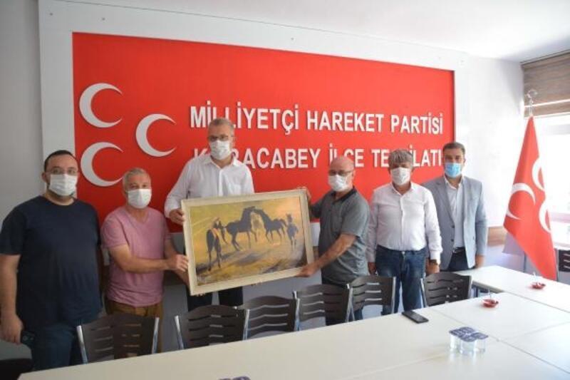Karacabey'de Başkan Özkan'dan MHP ilçe teşkilatına ziyaret